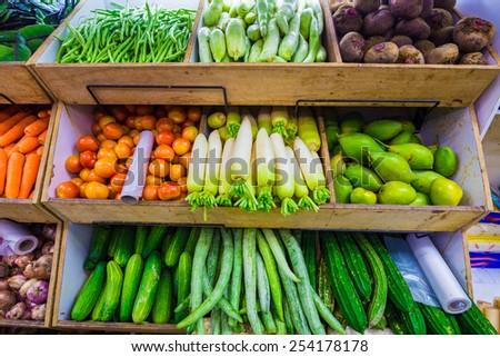 Composition with assorted fresh raw organic vegetables in little india market, Singapore - stock photo