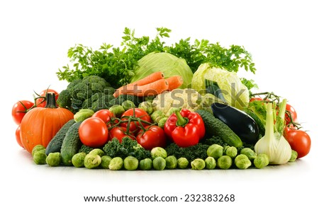 Composition with assorted raw organic vegetables isolated on white - stock photo