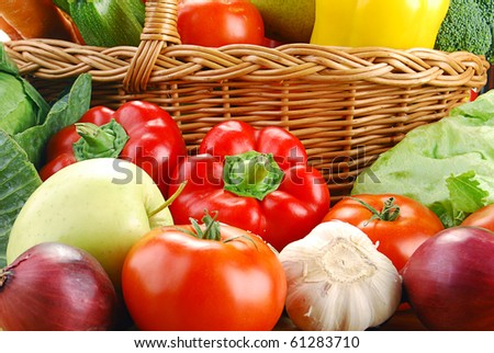 Composition with basket and vegetables on kitchen table