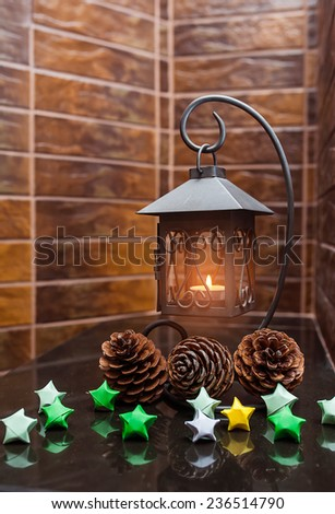 Composition with beautiful candlesticks, cones and other decorations for home interior on wooden background. - stock photo