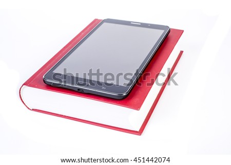 Composition with books and tablet computer.