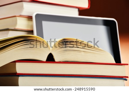 Composition with books and tablet computer on the table. - stock photo