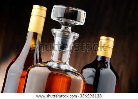 Composition with bottles of assorted alcoholic beverages - stock photo