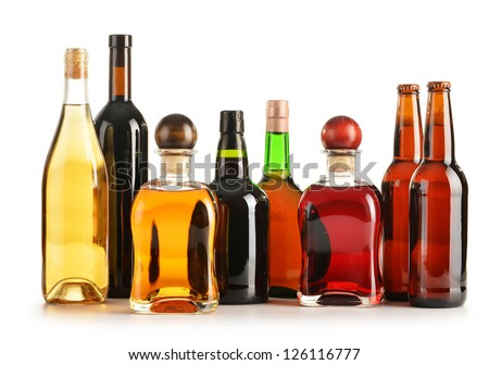 Composition with bottles of assorted alcoholic products isolated on white