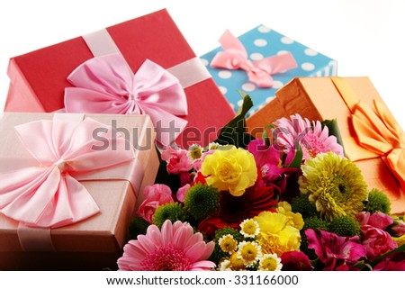 Composition with bouquet of flowers and gift boxes isolated on white