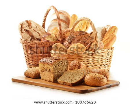 Composition with bread and rolls in wicker basket isolated on white. Cereal products. - stock photo