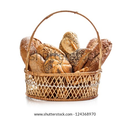 Composition with bread in wicker basket - stock photo