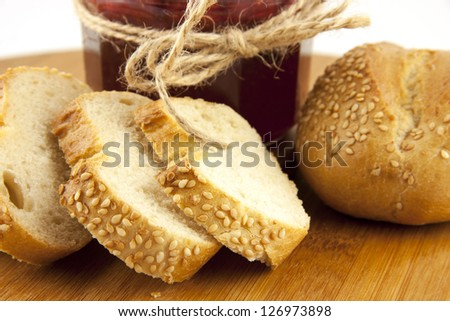 composition with bread rolls and strawberry jam