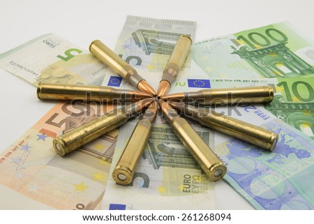 composition with bullets and banknotes - stock photo