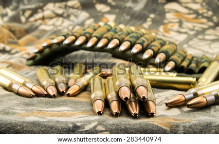 composition with camouflage ammunition belt for assault rifle - stock photo