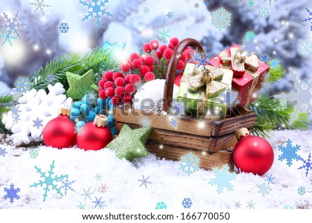 Composition with Christmas decorations in basket, fir tree on light background