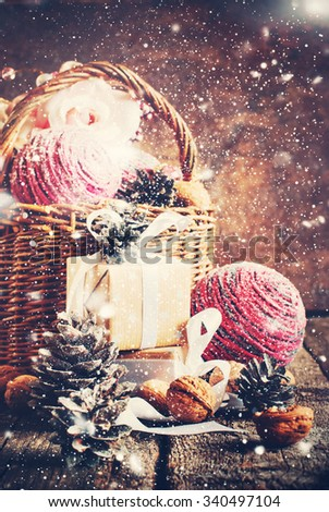 Composition with Christmas Gifts, Box, Basket, Pine Cones, Walnuts. Effect of Drawn Snow - stock photo
