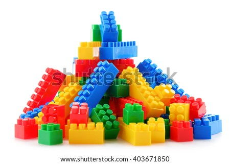 Composition with colorful plastic children toys isolated on white - stock photo