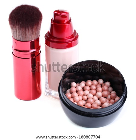 Composition with concealer, powder balls and brush isolated on white - stock photo