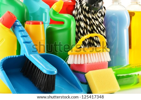 Composition with detergent bottles and chemical cleaning supplies - stock photo