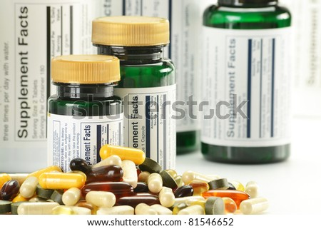 Composition with dietary supplement capsules and containers. Variety of drug pills