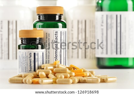 Composition with dietary supplement capsules. Drug pills - stock photo