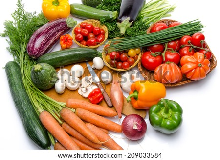 Composition with different fresh vegetables, isolated on white