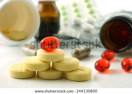 Composition with different pills and tablets. Vitamin supplements. - stock photo