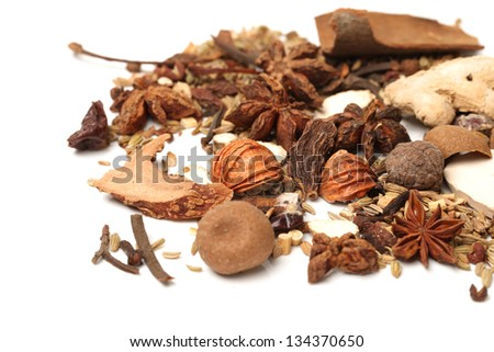 composition with different spices and herbs isolated on white background