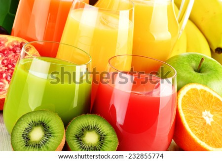 Composition with glasses of assorted fruit juices. Detox diet - stock photo