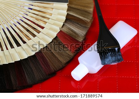 Composition with hair samples of different colors, brush and color on table background