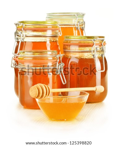 Composition with jars of honey isolated on white background - stock photo