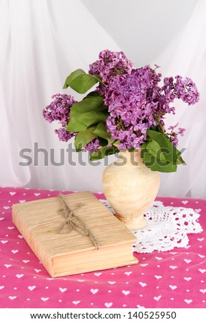 Composition with lilacs on bright background