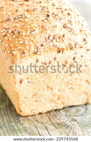 Composition with loaf of bread on wooden table - stock photo
