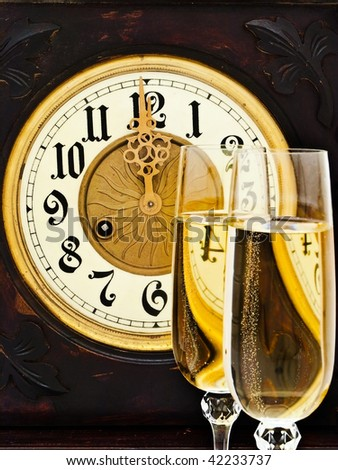 Composition with old clock and two glasses of champagne