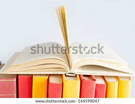 Composition with open books on white background
