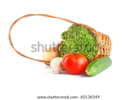 Composition with raw vegetables, in rod basket on white background