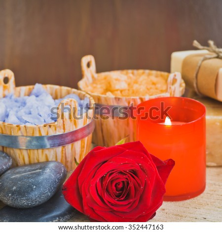Composition with sea salt, stones,soap, candles and flower