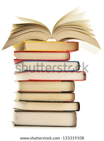 Composition with stack of books isolated on white - stock photo
