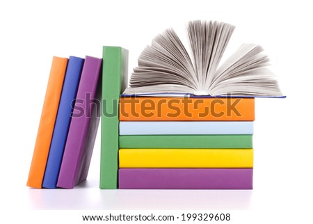 Composition with stack of books on a white background.
