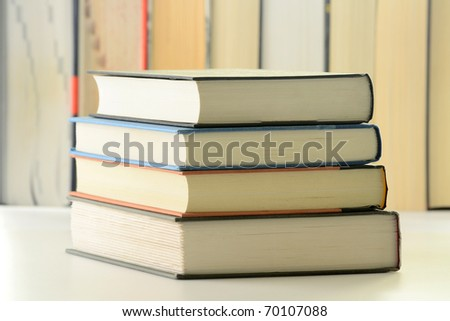 Composition with stack of hardcover books