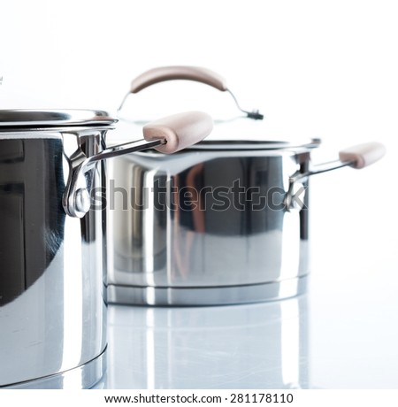 Composition with stainless pots.Selective focus.Little of DOFF - stock photo