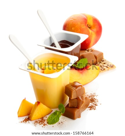 Composition with tasty desserts, pieces of fresh fruits and toffee candies,  isolated on white