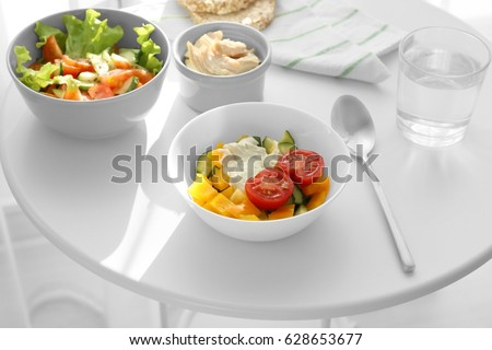 Composition with tasty yogurt on table in room