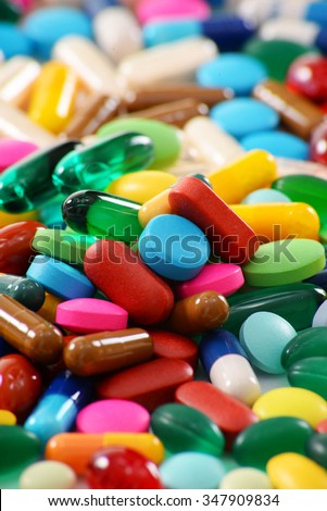 Composition with variety of drug pills and dietary supplements. - stock photo