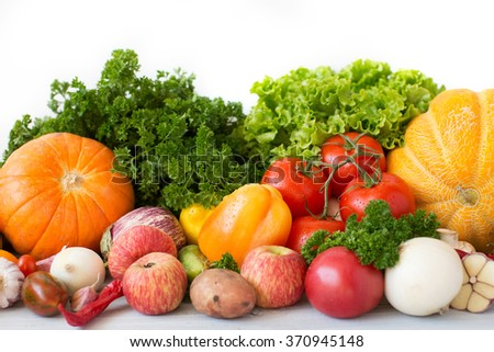 Composition with variety of fresh vegetables and fruits top view. - stock photo