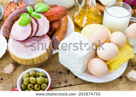 Composition with variety of grocery products including meat and dairy - stock photo