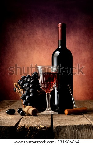Composition with wine and grape on wooden table - stock photo