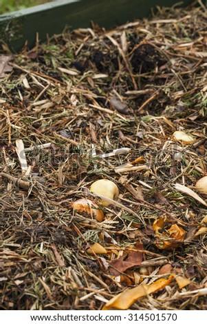 Compost bin in a garden. - stock photo