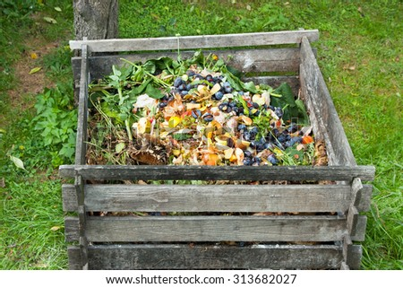 compost bin in the garden composting pile of rotting kitchen fruits