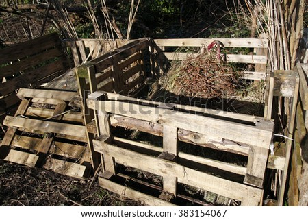 Compost bins made from old pallets in an allotment
