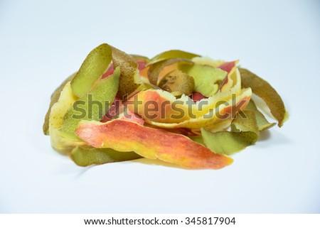 Composting pile of rotting kitchen fruits  on white background - stock photo