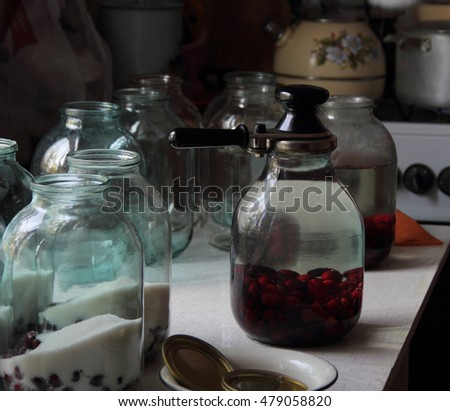 compote of berries of dogwood in a clear jar on your Desk, storage for the winter