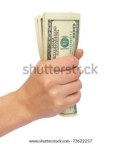 Compressed bundle of dollars a female hand on a white background