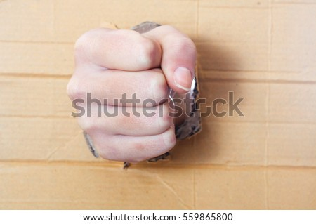 Compressed hand in a fist punch board